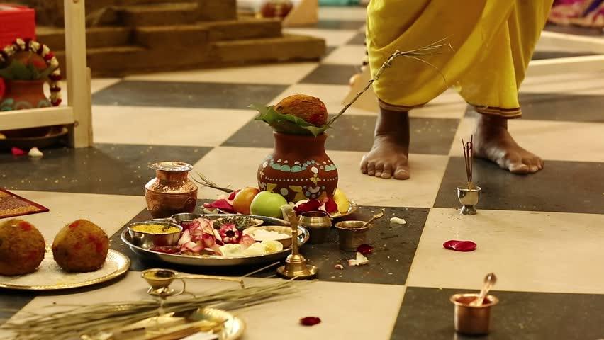 Deity installation ceremony in the Krishna temple, feet of Krishna worshipper