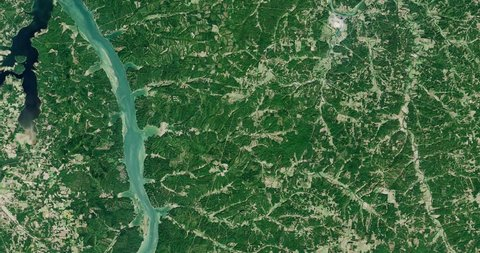 Very high-altitude overflight aerial of forest, lakes and farmland, western Kentucky. Clip loops and is reversible. Elements of this image furnished by NASA