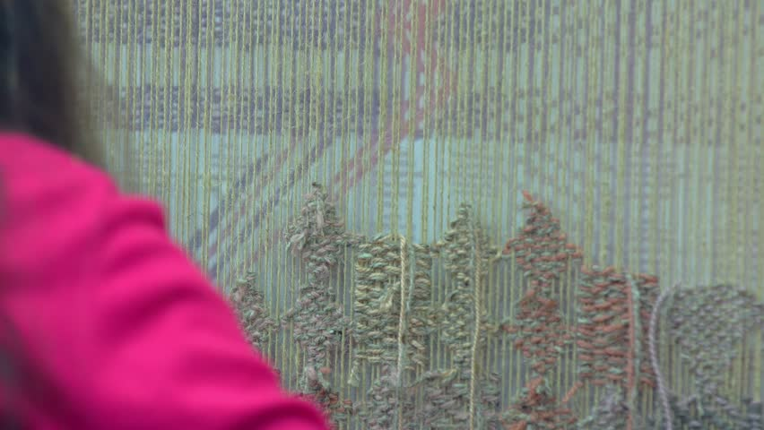 Young girl Hands Weaving Carpet Closeup, Ethnic production, 4K. Wool yarn.