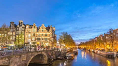 Amsterdam city skyline day to night timelapse at canal waterfront, Amsterdam, Netherlands 4K Time Lapse