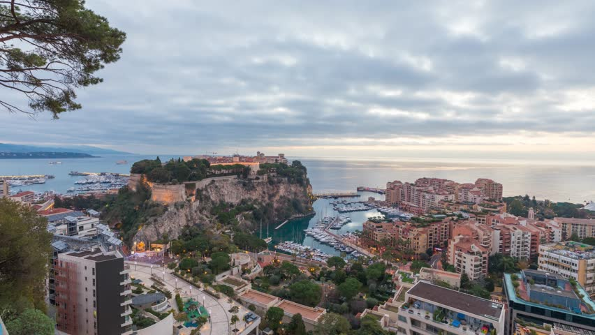 Sunrise in Monaco: zoom in view on port Fontvieille and Rock of Monaco with old town - time lapse video