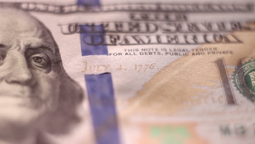 Tracking macro of Benjamine Franklin's face on the US one hundreed dollar bill. US dollars background.   Shutterstock HD Video #34249354