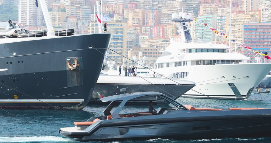 Monaco, Monte-Carlo, 29 September 2017: The largest fair exhibition in the world Yacht show MYS, port Hercules, a lot of new mega yachts, rich clients, brokers, sunny weather, boat traffic in marina
