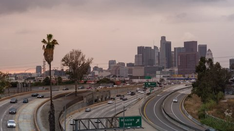 Los Angeles, California, USA - November 1st 2017 - Downtown Los Angeles and Freeway Day to Night Cloudy Sunset Timelapse