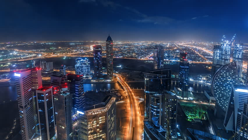 Nighttime skyline of a big modern city. Scenic aerial view of downtown Dubai, UAE with skyscrapers and highways. 4K time lapse.  #34351414