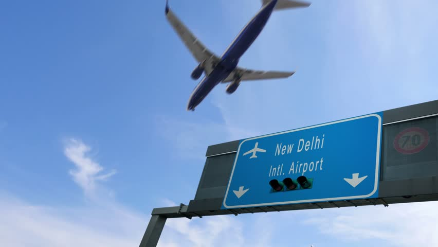 Airplane flying over new delhi airport signboard | Shutterstock HD Video #34354294