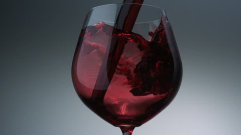Pouring red wine into glass shooting with high speed camera, phantom flex.