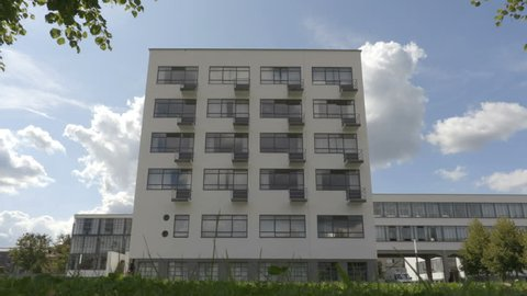 Dessau-Rosslau / Germany - 09.05.2017: View on the Bauhaus facade from below with the cloudy sky on the background