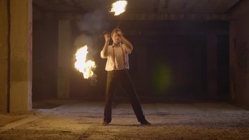 Male artist performing fire show at dark abandoned building in slow motion. Fireshow in ruins at night. | Shutterstock HD Video #34365994