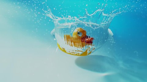 Rubber Duck hits Water Surface in Slow Motion.  Phantom Flex - 4K - 1000fps