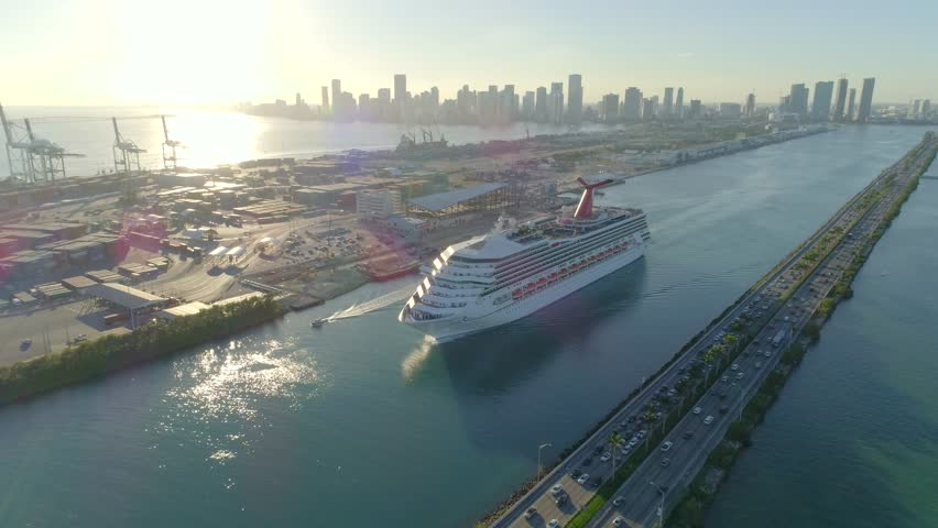 MIAMI BEACH, FL, USA - DECEMBER 29, 2017: Aerial drone video of a cruise ship departing Miami through Government Cut Inlet by Port Miami