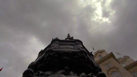 Birds landing on the Eros statue in London