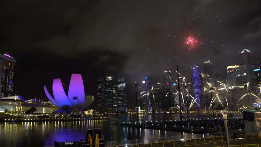 Marina Bay, Singapore - January 01, 2018: HD b-roll cinematic footage of new year eve 2018 fireworks show at Marina Bay, Singapore. Pan left #34441144