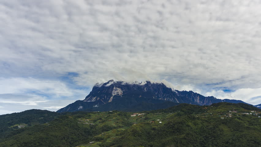 4K Time lapse of day view and dancing clouds over Mount Kinabalu in Sabah Borneo, Malaysia.