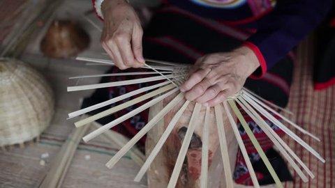 Bamboo handicrafts thai, closeup hand and bamboo