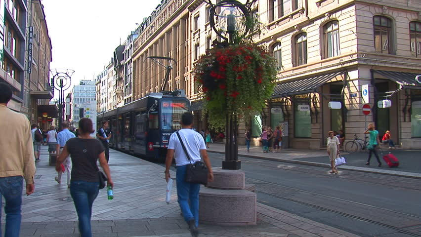 GENEVA, SWITZERLAND - AUGUST 16: tram rides along the street on August 16, 2012 in Geneva, Switzerland.