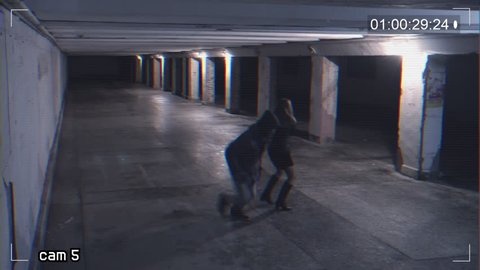 robbing a girl talking on the phone in an underpass. Recording from a surveillance camera