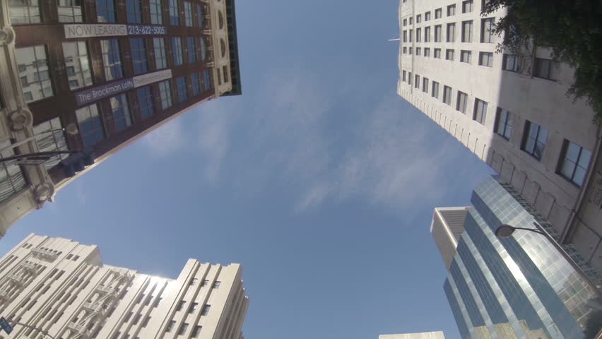 Shot in slow motion at 60fps through downtown Los Angeles looking up at the buildings.  POV with flare
