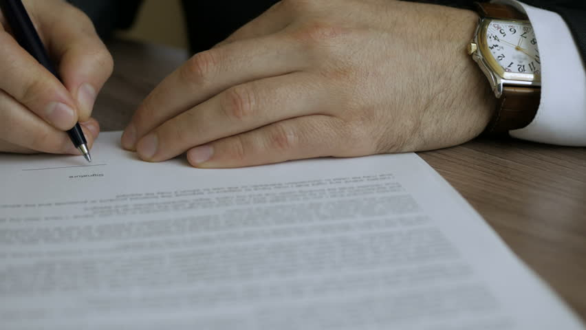 Businessman signing business contract agreement, close up of male hand with pen writing signature. The man corrects and fills the document. | Shutterstock HD Video #34566724