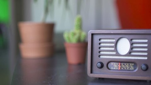 Vintage Radio on Table and Out of Focus Cactus in Background Camera Sliding Left to Right
