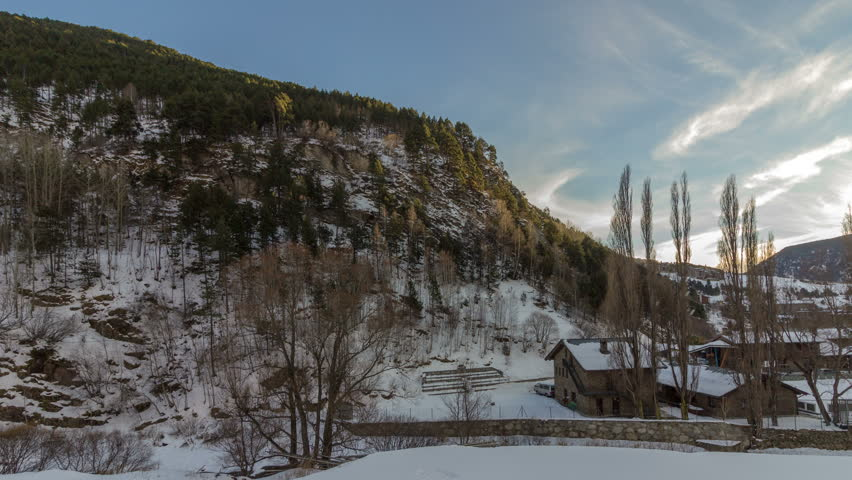 Timelapse sunset shadow over mountain, view from town of Canillo. Principality of Andorra.