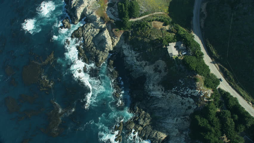 Aerial view along Big Sur rocky coastline and Cabrillo Highway coast road from Kaiser Point California USA RED WEAPON