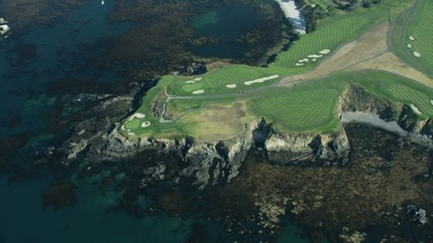 Aerial view around Arrowhead Point Pebble Beach golf course yachts anchored Stillwater Cove Carmel Big Sur California USA RED WEAPON