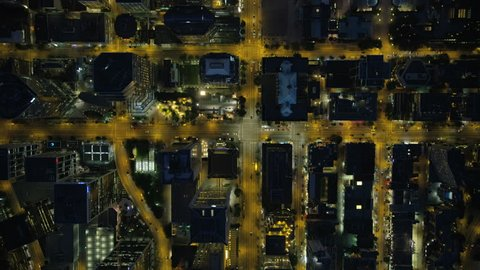 Aerial rooftop night view illuminated lights downtown Vancouver and evening commuter travel on city streets British Columbia Canada RED WEAPON