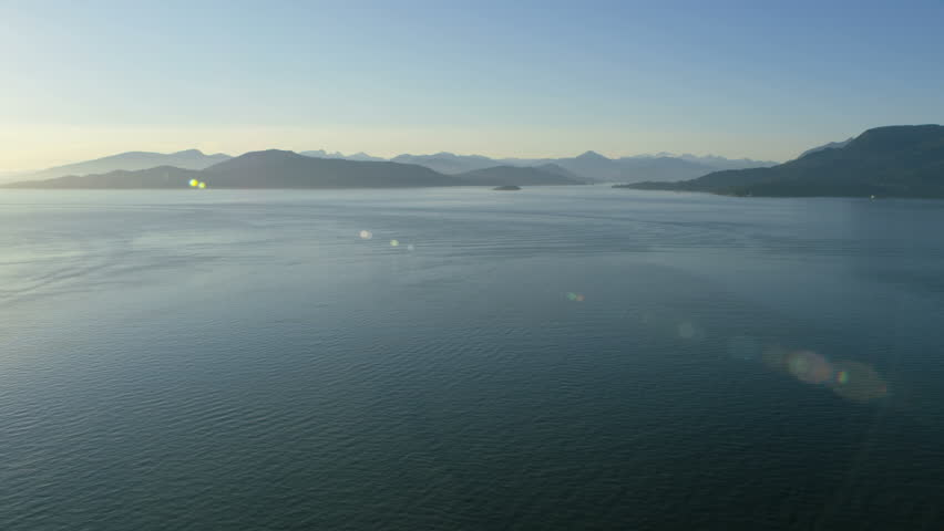 Aerial sunset view over tranquil ocean towards Horseshoe Bay and Bowen Island Ecological Reserve Vancouver British Columbia Canada RED WEAPON