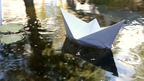 Paper boats floating in the river, 4k