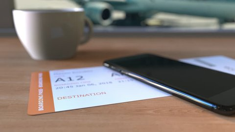 Boarding pass to rawalpindi and smartphone on the table in airport   travelling to pakistan conceptual animation