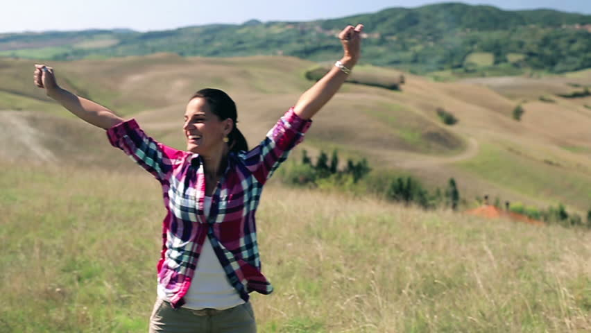 Young woman enjoying panoramic view of Tuscany, slow motion