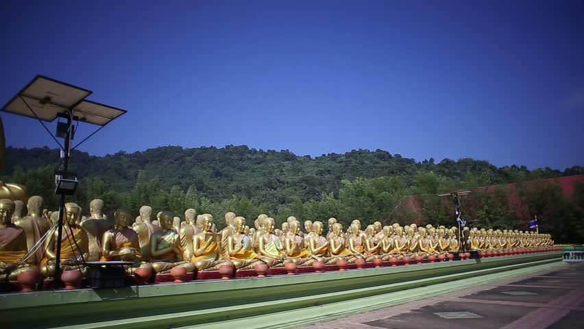 Buddha and massive apostles statue