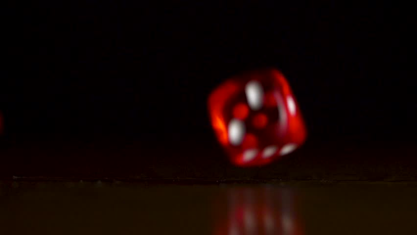 Two dice falling on table. Defocused footage of two dice falling on table. Two red dice falling on the table