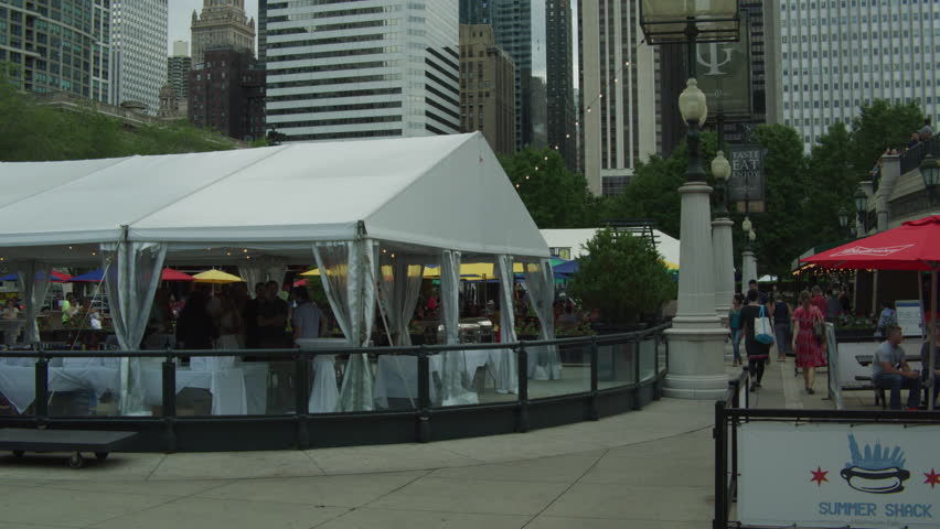 Day Shot begins some outdoor cafes people eating then tilt up Chicago cityscape | Shutterstock HD Video #34685824