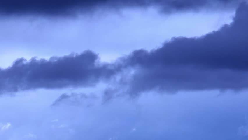 Stormy clouds after a rain, thunderstorm weather with blue weather time, supercell rolling faast moving cloud. Dark storm clouds are moving fast at viewer - timelapse, 1920x1080. Full HD. | Shutterstock HD Video #34686664