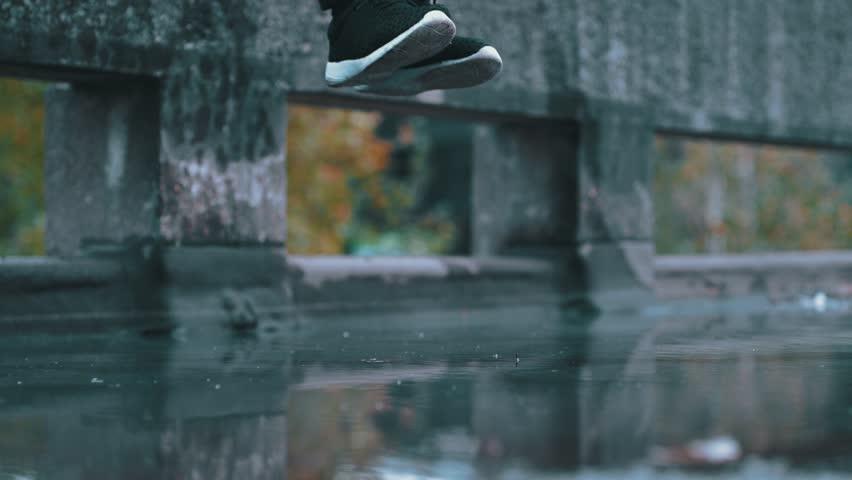Super slow motion free running acrobat in street shot on Phantom Flex 4K | Shutterstock HD Video #34693024