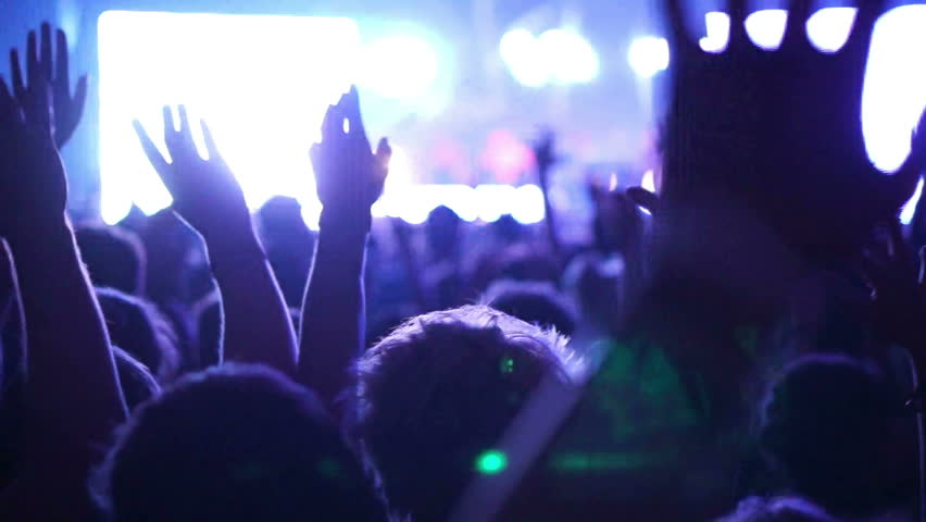 Shot of some cheering fans at a concert, slow motion, some visible noise due high ISO, soft focus, also normal speed version of this video available in my portfolio