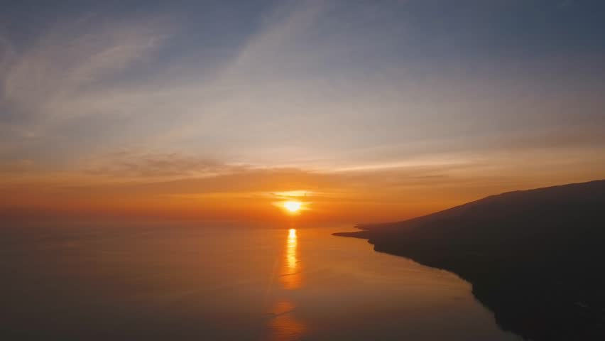 Sea coast at sunset. Aerial view of sunset on the ocean coast, sea, beach, sky, clouds. Bali, Indonesia. Sunset on the island of Bali. 4K, Aerial footage | Shutterstock HD Video #34755424