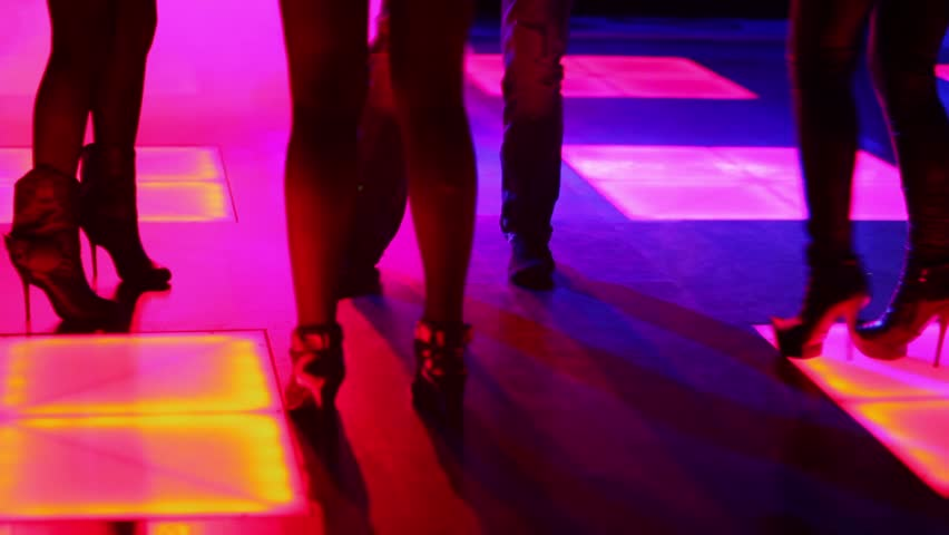 Three women and one man dance in night club, only legs are visible #3477164
