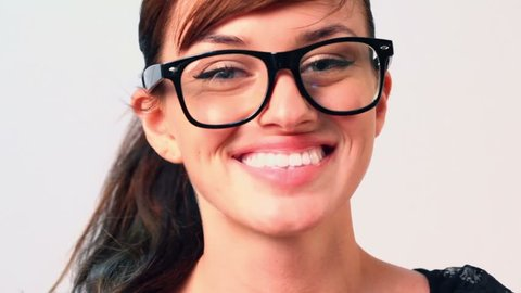 Beautiful woman in big black glasses smiles and looks