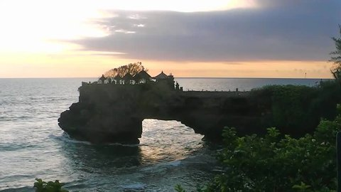 Sunset and sea surf near Ta-nah Lot Temple, Bali, Indonesia