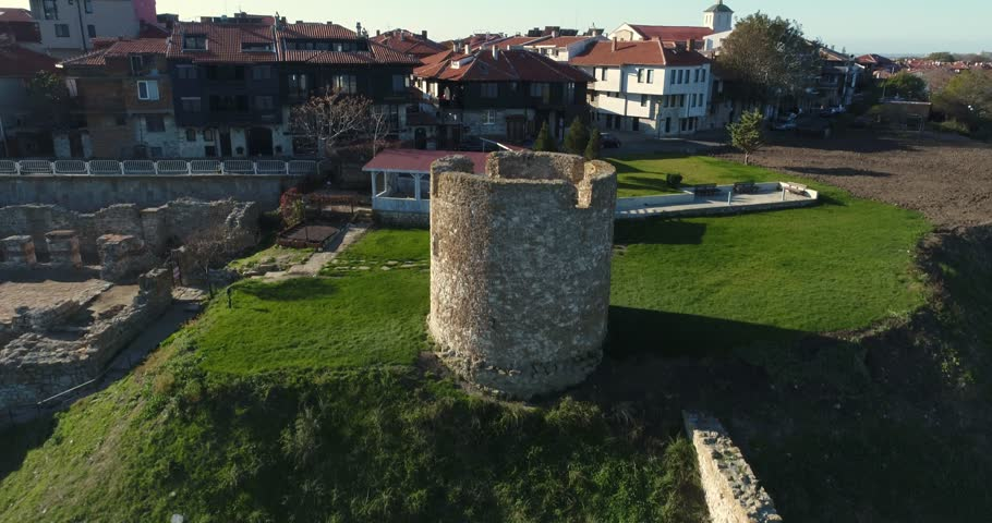 4k aerial video of ruins of ancient watchtower and Nessebar, ancient city on the Black Sea coast of Bulgaria.