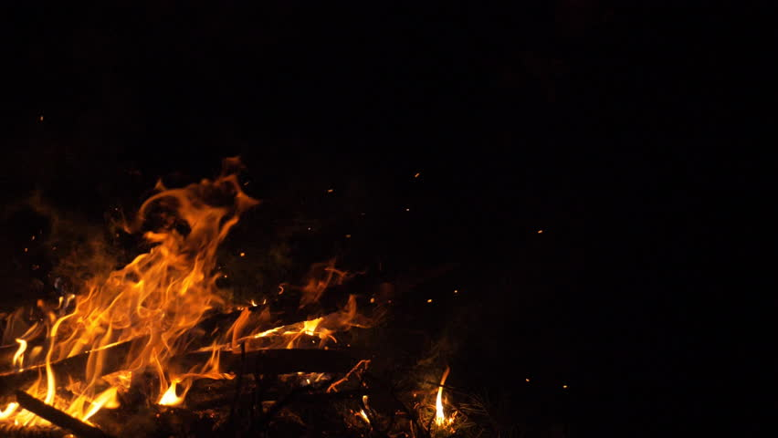Fire in nature. Bokeh from the fire. Blurred backgrounds. Space views. Sparks are beautifully flying right at you. Shooting speed 60fps, slow motion. Live shooting of the most beautiful flame. | Shutterstock HD Video #34804474