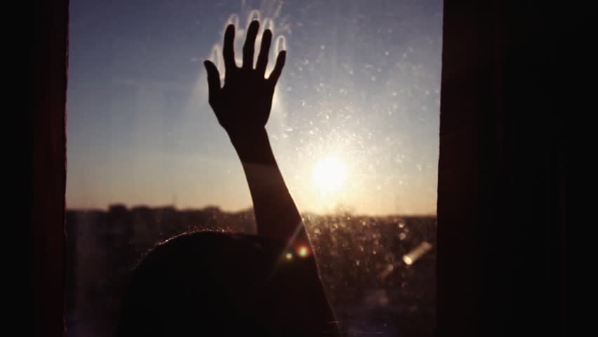 Close-up. Hand slides down the window against the sunset | Shutterstock HD Video #34840690