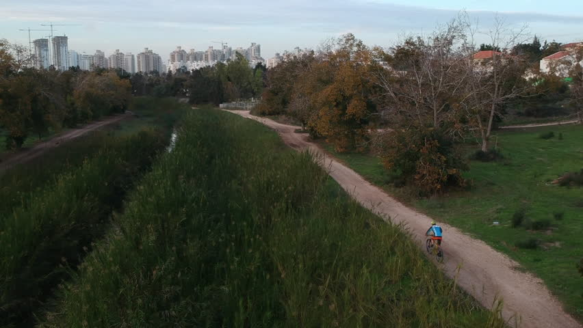 Aerial drone shot of bicycle rider | Shutterstock HD Video #34840894