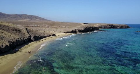 AERIAL: Scenic view of Papagayo beach on the island of Lanzarote, Canary Islands, Spain, Europe.