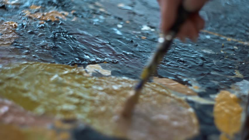 Artist mixes paints on the palette before painting a picture, painter at the studio, creator makes piece of art | Shutterstock HD Video #34881574