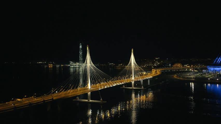 City skyscraper, night car traffic on cable stayed bridge and sports stadium | Shutterstock HD Video #34894183