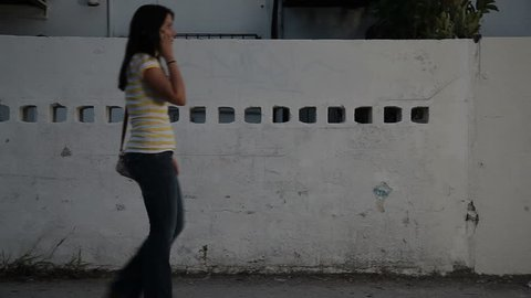 girl walking late at night, being watched by mugger